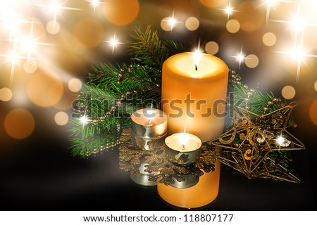 Christmas Decorations background - beads; star, tree candles on fir tree branch - stock photo