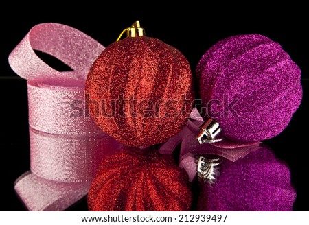 christmas decorations balls on a black background - stock photo