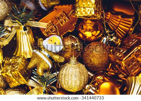 Christmas decorations box with stars, toys and ornaments. Golden baubles and ribbons - stock photo