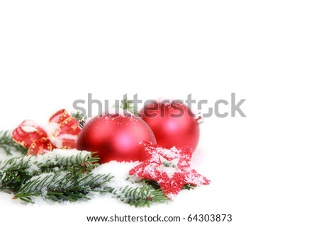 Christmas decorations covered with snow - stock photo