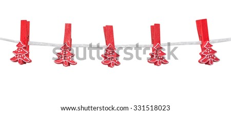 Christmas decorations, empty red spruce clothespegs (clothespin) hang on a rope, isolated on the white - stock photo