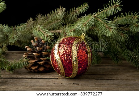 Christmas decorations fir branch on a black background - stock photo