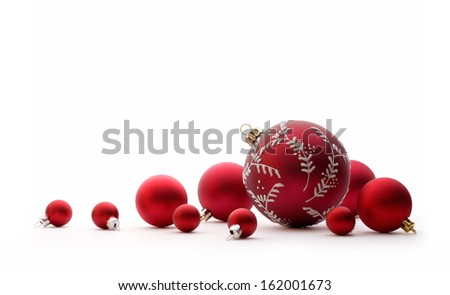 Christmas decorations: group of red Christmas balls, Christmas tree decorations, isolated on white background - stock photo