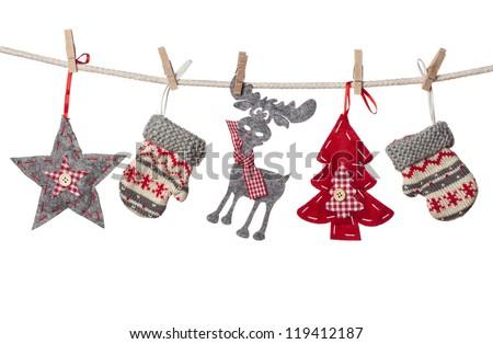 Christmas decorations hanging isolated on white background - stock photo