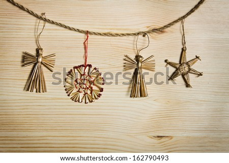 Christmas decorations hanging over wooden background  - stock photo