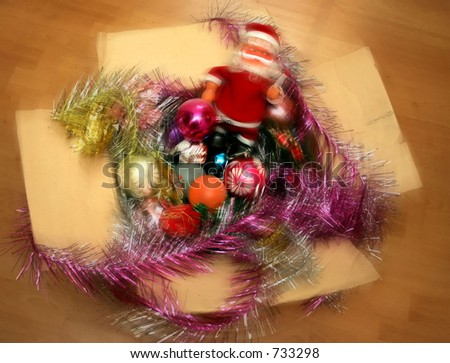 Christmas decorations in a carton  box with a slight radial blur. - stock photo
