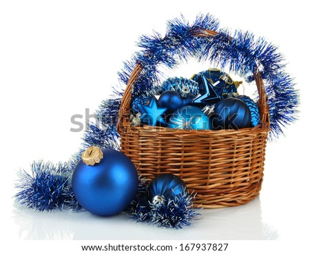 Christmas decorations in basket isolated on white - stock photo