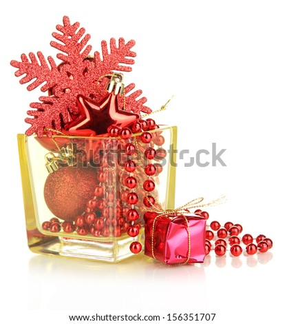 Christmas decorations in glass vase isolated on white - stock photo