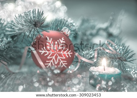 Christmas decorations in red, green and silver. Shallow DOF, focus on the snowflake pattern. - stock photo