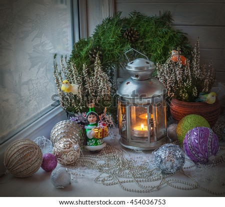 Christmas decorations  in the window eve of holiday (products of mass production) - stock photo