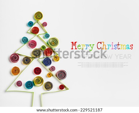 Christmas decorations made of paper quilling with space for greetings - stock photo