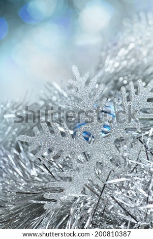 Christmas decorations. New Year snowflake in tinsel and spangles. - stock photo