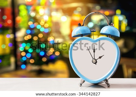 Christmas decorations , old retro clock on wooden, abstract background to time for count down to Christmas and new year Holidays. - stock photo