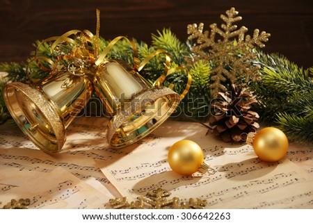 Christmas decorations on music sheets, closeup - stock photo