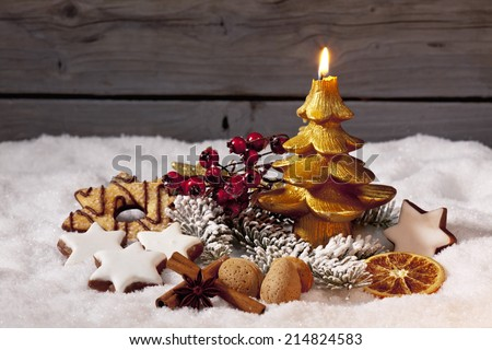 Christmas decorations on pile of snow - stock photo