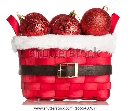 Christmas decorations on red basket - stock photo