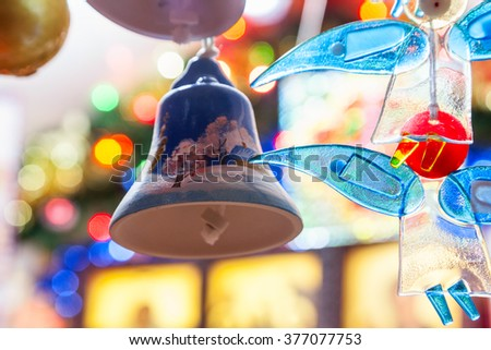 Christmas decorations on sale at the market, shallow DOF - stock photo