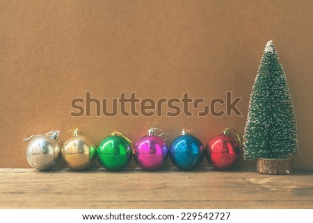 Christmas decorations on wooden background , vintage color tone.  - stock photo
