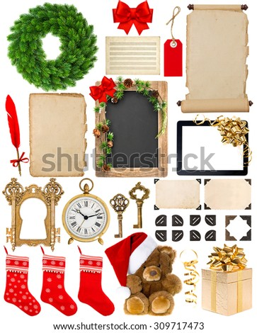 Christmas decorations, ornaments and gifts. Old book pages, paper, wreath, scroll, blackboard, corner and photo frame isolated on white background - stock photo