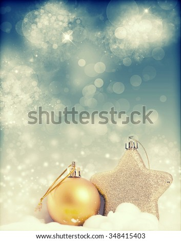 Christmas decorations over sparkling holiday background - stock photo