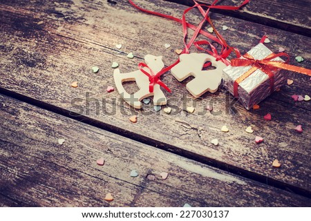 Christmas decorations over wooden background - stock photo