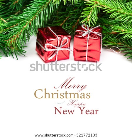 Christmas Decorations. Tree branches with red gift box isolated over white with copy space for text. Holiday festive Xmas card - stock photo