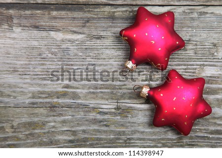 Christmas decorations. Two red stars on a wooden background - stock photo