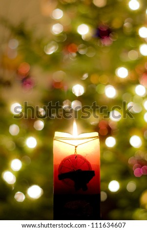 christmas decorations with burning candle - stock photo