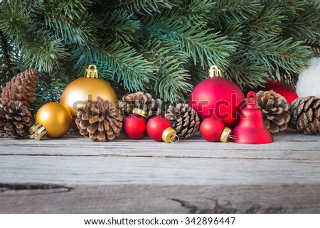 Christmas decorations with fir and pine cones on wooden table - stock photo