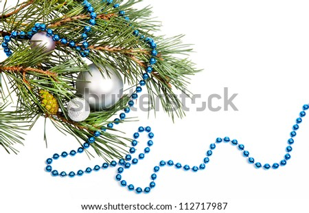 Christmas decorations with silver balls and blue beads on white background - stock photo