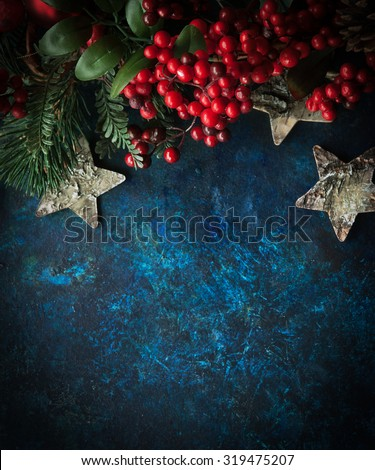 Christmas decorative background with stars and winter berries with place for text - stock photo