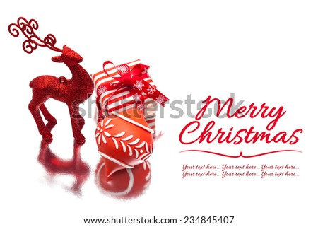 Christmas deer gift box and ornament on white background.  Christmas greetings template. - stock photo