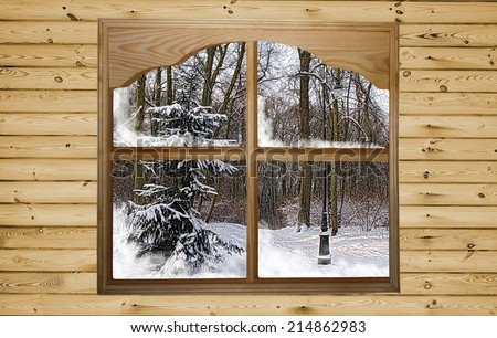 Christmas design. Winter christmas concept - a beautiful view of winter from the wooden window in wooden wall. - stock photo