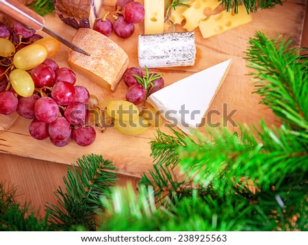 Christmas dinner at home, cheese and wine table setting, cozy atmosphere, Christmas eve celebration - stock photo