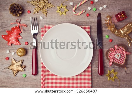 Christmas dinner background with rustic decorations. View from above - stock photo