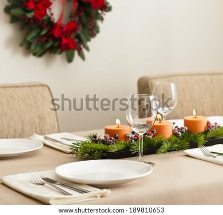 Christmas Dinner table setting in beige orange color - stock photo