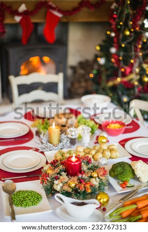 Christmas dinner table with food at home in the living room - stock photo