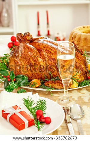 Christmas dinner table with roasted turkey - stock photo