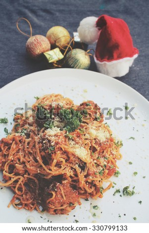 Christmas dinner table with spaghetti and meatballs  - stock photo