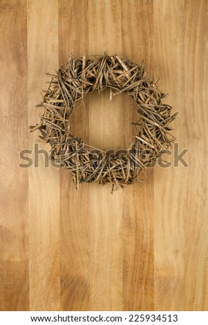 Christmas door wreath light brown twigs on sapele wood background, copy space - stock photo