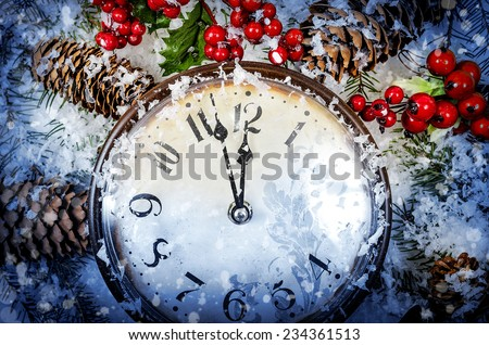 Christmas Eve and New Years at midnight. Clock covered with snow  - stock photo