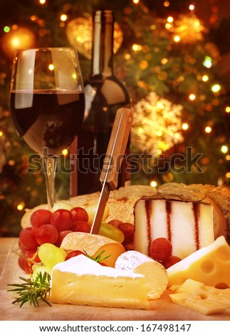 Christmas eve dinner, fine dining restaurant, romantic cheese and wine table, winter holidays celebration  - stock photo