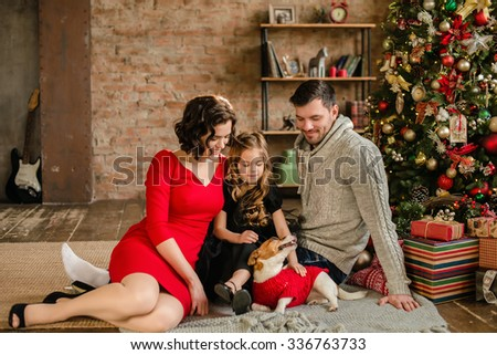 Christmas Family Portrait In Home Holiday Living Room, Kids and dog play, Present Gift Box, House Decorating By Xmas Tree Candles Garland - stock photo