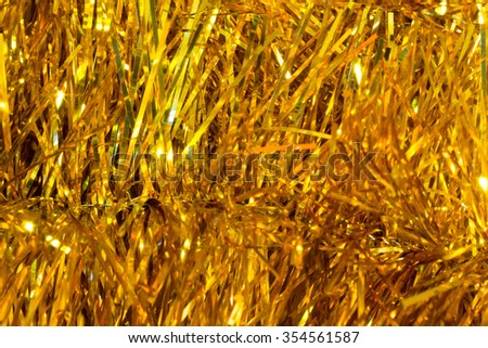 Christmas festive background of shiny Christmas tree tinsel. Selective focus. Blurred macro photo. The concept of Christmas and new year - stock photo