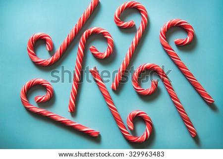 Christmas festive candy canes on blue pastel background - stock photo