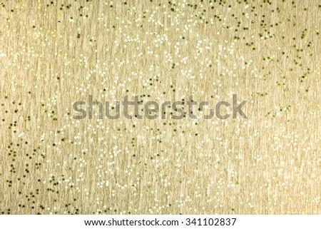 christmas festive decoration of golden glittery confetti stars - stock photo