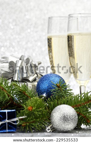 Christmas fir branch and decoration on abstract silver background - stock photo