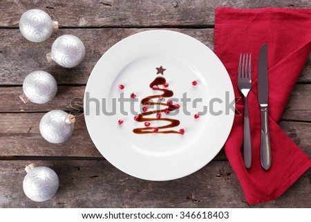 Christmas fir tree made from chocolate on plate, close up - stock photo
