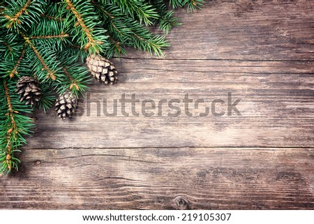 Christmas fir tree on a wooden background - stock photo