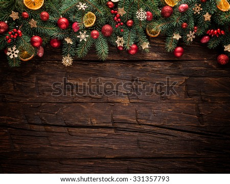 Christmas fir tree with decoration on a wooden board. Copy-space for text - stock photo